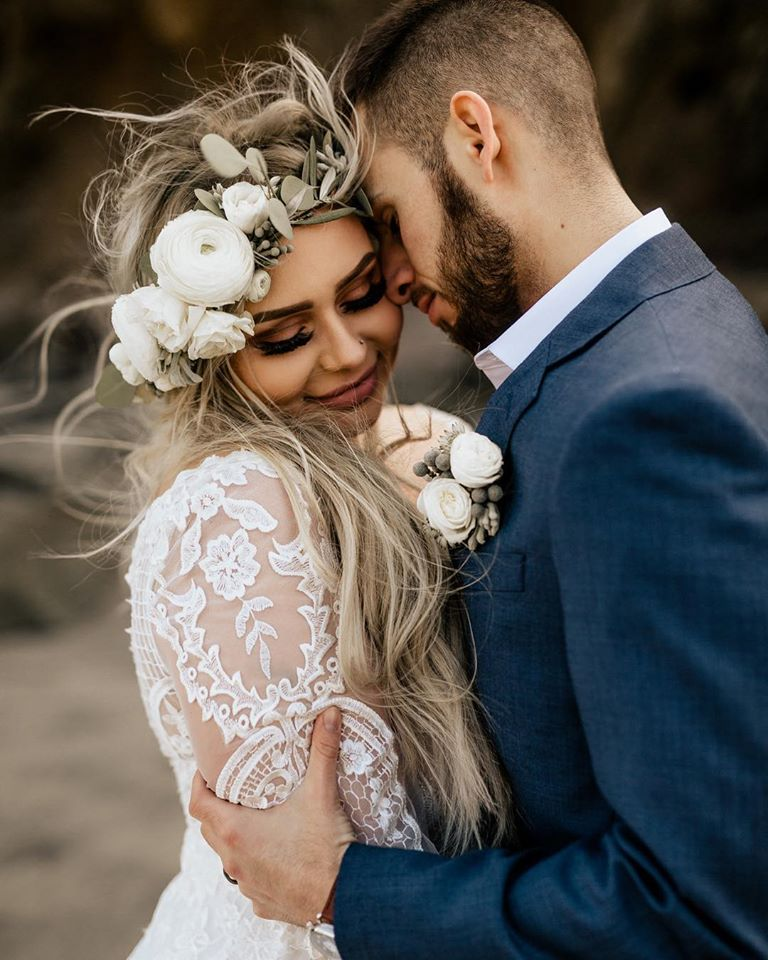 Flower crown and boutonnière for the love birds.